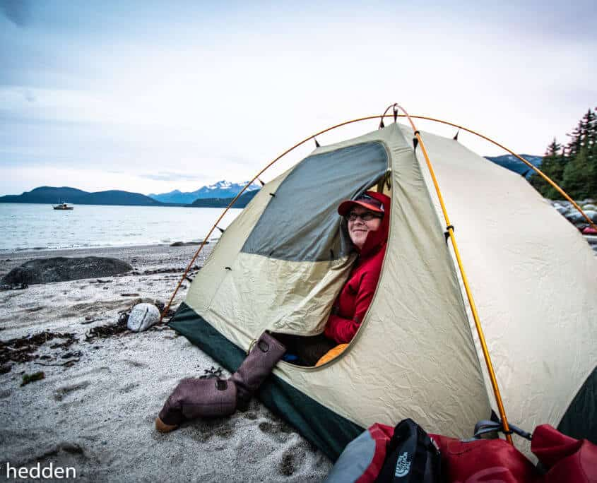 a person inside a tent on a beach