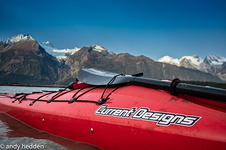Photo of a kayak with a snowy mountain background